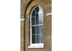 Traditional, round-headed sliding sash from Wood Window Alliance member, Mumford & Wood