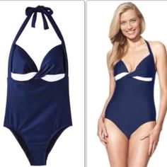 New Medium swim top New but no tags. Size Medium.This women's colorblock swimsuit from Merona will add a touch of wow to your look. This navy and white swimsuit is made of a nylon and spandex blend fabric for stretchy fit. This 1-piece swimsuit is lined in 100% polyester. Its molded cups and halter straps offer lift and support. Comes with an easy behind the neck tie.  2 available but sold separately Merona Swim One Pieces