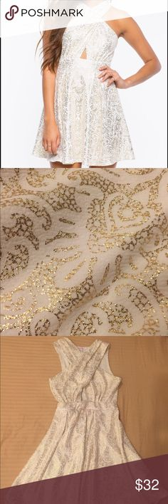 A'gaci Cross Halter Paisley Shine Dress Size M Beautiful white cross halter fit and flare dress with gold paisley foil. Worn once! Perfect condition !! Absolutely adorable, I got soo many compliments when I wore it! a'gaci Dresses Mini