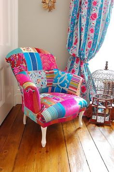 The Mandalay Chair by Deborah Swift/Couch. I kind of like this one too. My taste in furniture seems to be rather eclectic. Chris would move out.
