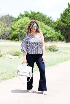 31a8ae9034 One-shoulder statement sleeve gingham top and white handbag for summer 2017  outfit inspiration.
