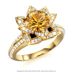 The flower ring obsession continues. This site lets you design your own jewelry. Citrine Lotus Flower Royal Ring by Jeet Palavwala