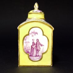 An 18th Century Meissen Porcelain Yellow Ground Tea Canister and Cover. Decorated in Puce Camieux with Scenes After Jean-Antoine Watteau. Jean-Antoine Watteau (1684–1721) was a French painter whose brief career spurred the revival of interest in colour and movement. He is credited with inventing the genre of fêtes galantes: scenes of bucolic and idyllic charm, suffused with an air of theatricality. From the estate of Niel Rimington (1928-2009) of Fonthill Old Abbey Estate, Wiltshire.