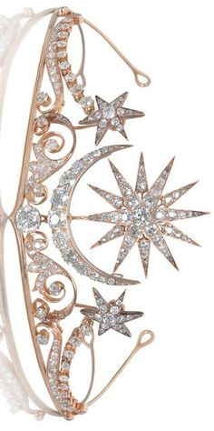 A diamond tiara/broochring combination, circa 1900. The central sunburst and crescent moon motifs above a large cushion-shaped diamond, on a scrolling frame of shooting stars, set throughout with old brilliant-cut diamonds, mounted in gold, principal diamond approximately 1.75 carats, remaining diamonds approximately 14.00 carats total, brooch, hair ornaments, ring and tiara fittings and screw supplied, fitted case by Cav. Vincenzo Giura Giojelliere, Napoli,