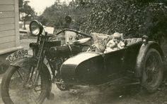 Early twenties J model Harley with unknown brand sidecar attached.