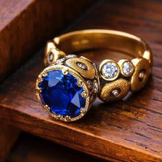 Featuring sapphires. Orchard ring with blue sapphire and diamond accents. alexsepkus
