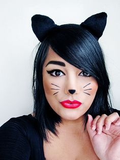 Simple Halloween look - Cute cat. This look can be achieved with the help of Sleek Pout Paint 'Pin Up' combined with Sleek Eau La La Liner! You don't have to spend a fortune to look good on Halloween!