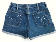 Vintage upcycled 90s mom jeans cut and cuffed into a high-waisted pair of shorts    Constellation and star detailing hand-embroidered with shiny [patch]