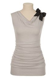 Sleeveless banded bottom top with bow.  $26.00