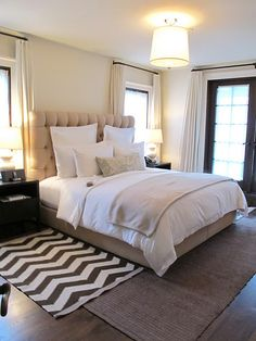 love the layered rugs and beds with the upholstered headboards are so pretty to me :)