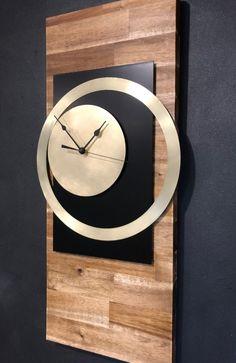 Quality quartz solid acacia wood wall clock with genuine brass trim.