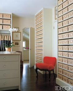 Rows of fabric-covered boxes containing shoes and hats fill the dressing room shelves in textile designer Gretchen Bellinger's upstate New York home, decorated by Andrew Fisher and Jeffry Weisman. The Frog chair by Michael Taylor Designs is upholstered in a Bellinger cotton velvet.