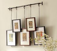 I am repinning but I saw this at Pottery Barn. It sells for $99 w/o the frames. Love it!