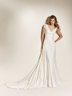 a110e3283 CHADIA  Simple but radiant. Crepe wedding dress with a V-neck in the