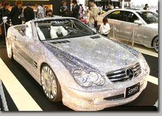 This diamond-studded, mink-furnished Mercedes SL600, worth $4.8 million, was unveiled at a Dubai auto show to celebrate the 50th anniversary of the Mercedes Benz SL550 in 2007.      BLING!!!