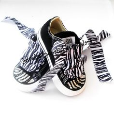 Dont know what I am going to do with my daughters converse yet but I was thinking something like this? Love zebra print!
