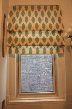 Faux Roman Shades Use 3 tension rods to make this shade