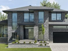 Modern and dark stone exterior Rinox Lotis stone in Charcoal color