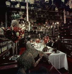 Attended by a uniformed waiter, patrons dine in the wine cellar of the famed Blue Fox restaurant. The Blue Fox was on 659 Merchant St., right across from the city morgue, and was a favorite of celebrities who would fly up from L.A. to eat there. Joan Crawford had her own store of vodka kept on-hand. Photo: Nat Farbman/The LIFE Picture Collection/Getty Images