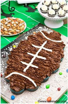 Celebrate the big game by throwing a fun football party! This dessert table is packed with lots of yummy snacks and football pull apart cupcakes!