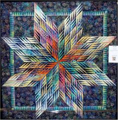 Paper Star, 61 x 61, by Carol Caplan.  Pattern by Karen Stone
