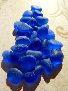 Cobalt Blue Sea Glass - this amazing color comes from medicine/bitters/Vicks/Milk of Magnesia bottles of the early - and it is sublime! Cobalt Glass, Cobalt Blue, Sea Glass, Cerulean, Glass Beach, Periwinkle, Aqua Blue, Purple, Azul Indigo