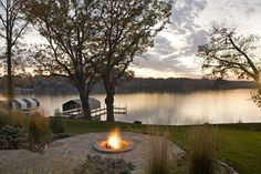 lakefront dock landscaping | This backyard set on a lake in the evening with a roaring fire to keep ...