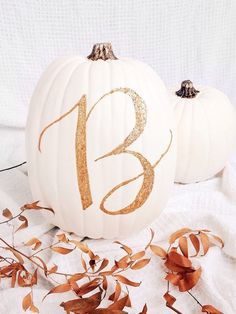 White pumpkins with gold initials for fall doorstep decorating or fall wedding decor. #fallwedding #fallweddingideas #pumpkins #whitepumpkins Image credit: White pumpkin with glitter