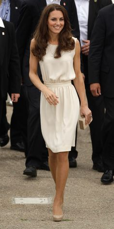 JULY 3, 2011 Catherine emerged in Prince Edward Island wearing this cream dress by the British company Joseph. She paired the look with the Nathalie clutch from L.K. Bennett and Links of London earrings.