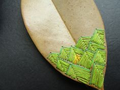 embroidery on a leaf
