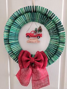 Christmas clothespin wreath available at www. Wreath Crafts, Craft Stick Crafts, Diy Wreath, Holiday Crafts, Wreath Ideas, Clothespin Crafts, Craft Ideas, Door Wreaths, Diy Crafts