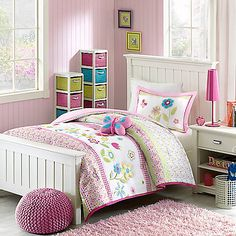 Brighten up your little girl's bed with the blossoming Mizone Kids Spring Bloom Reversible Comforter Set. Adorned with pink, green and blue butterflies and flowers, the charming bedding is a vibrant addition to your princess' bedroom.