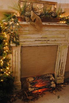 "Shabby Prim Christmas ""Fireplace"" & Mantel...lighted pine, old window mirror, & pinecones."
