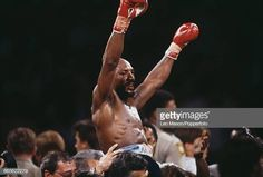 American boxer Marvelous Marvin Hagler celebrates with his arms in the air after knocking out his opponentThomas Hearns in the third round of the. Marvelous Marvin Hagler, American Boxer, Third, Arms, Wrestling, Celebrities, Boxing, Sports, Lucha Libre