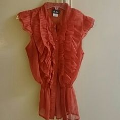 Ruffle blouse Orange blouse with ruffles in the front. Very cute. Great condition! ?? Dots Tops Blouses