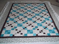 Pretty blue and white quilt with black.