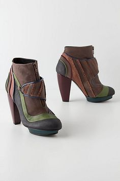 An unlikely partnership between a fashion designer and a hair stylist is behind Icelandic label Kron by Kronkron's timeless, feminine and exquisitely detailed designs, like these unique buttoned booties.    $498