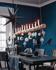 This heart shape candle holder would be amazing as wedding reception/engagement party decor pieces! You could hang initials etc from the hook! Love it!! Inspired!