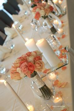 Head table decor, saves money to use bridesmaids bouquets at sweetheart table.