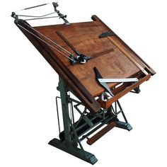 For Sale on - Attributed to Kahn Freres, Rare antique French adjustable industrial drafting table. Original green metal base and rich patina wood top. Antique Drafting Table, Industrial Drafting Tables, Antique Desk, Rare Antique, Wood Drafting Table, Metro Retro, Drafting Tools, Drawing Desk, Mcm Furniture