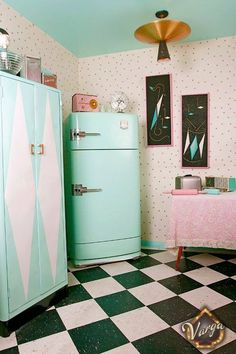 Love the design on the cabinets, maybe another idea for painted curtains.  Pretty turquoise and pink mid century kitchen.