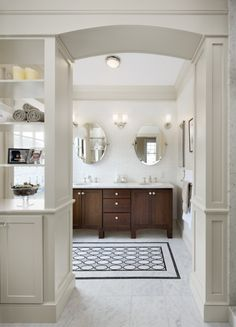 Love this faux rug/tile treatment in the middle of this stark white, but elegant bathroom.