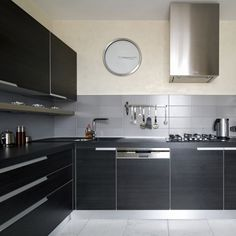 dark and medium greys are dominant in this kitchen, finished with stainless steel elements and oversized handles Stainless Steel Kitchen Design, Kitchen Island, Kitchen Cabinets, Kitchen Gallery, Cuisines Design, Colorants, Home Decor, Image Search, Kitchen Ideas