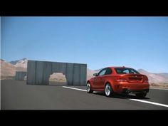 BMW 1 Series M Coupe takes on concrete walls on the track.
