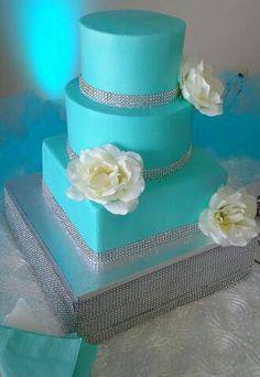 BEAUTIFUL TIFFANY BLUE WEDDING CAKE WITH DIAMOND BANDING AND SINGLE WHITE ROSES