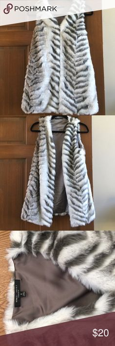 "NWOT fur vest NWOT fur vest from Romeo & Juliet Couture. Size Small. 4 clasp front closure. 2 side pocket. Beautiful white and gray with dark olive lining.  29"" from shoulder to bottom of vest. Romeo & Juliet Couture Jackets & Coats Vests"