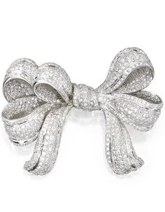 18 KARAT WHITE GOLD AND DIAMOND BROOCH.  Designed as a bow set throughout with numerous round diamonds weighing approximately 11.50 carats.