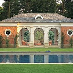 "Wadia  Located in Greenwich, this Georgian pool pavilion mimics the design of the main house. From the handcrafted brick to the limestone arches to the Doric Pilasters, this pavilion is a jewel nestled in the landscaped gardens. ""This elegant classical structure sits quietly in its surroundings, constructed of the best materials, which all contribute to the understated luxury,"" says Bunny Williams.  Professionals  Pool Design: Wadia  203-966-0048; wadiaassociates.com"