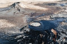 Black tar oozing out of a small crater at the Kilakupra Mud Volcanos in southeastern Georgia  #Georgia #TravelPhotography @goingthewholehogg