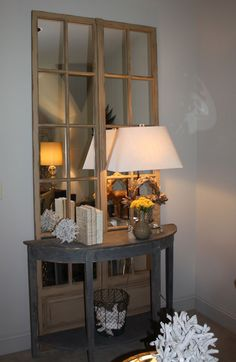 French doors W/mirror, small table and light at the fornt door